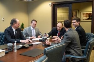 (from left to right) Colin Larsen, Director of Personal Finance Strategies; Matt Donohue, Financial Analyst; George M. Groome, Board Chair; Matt Groome, Co-CEO and Director of Retirement Plans; Erick Robinson, Investment Services Coordinator
