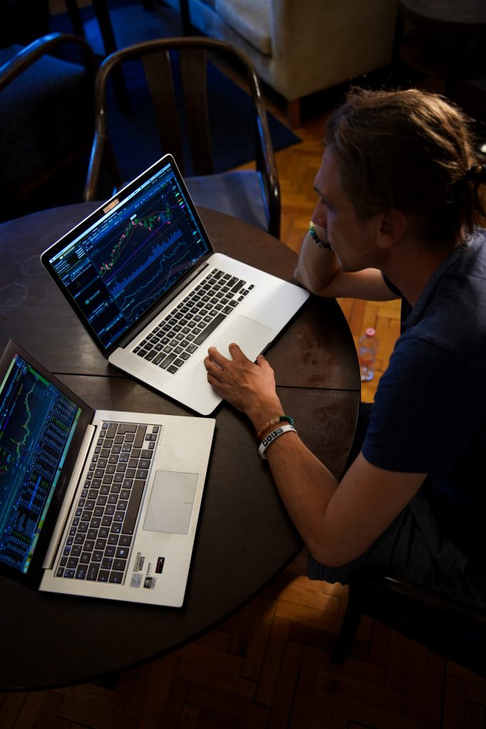 Laptop open to Stock Market Charts
